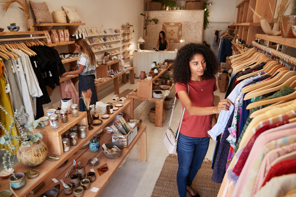 woman shops in a boutique retail store