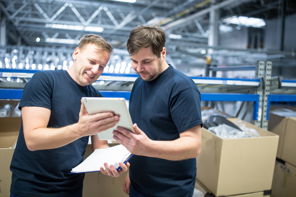 two employees consult a POS feature on iPad