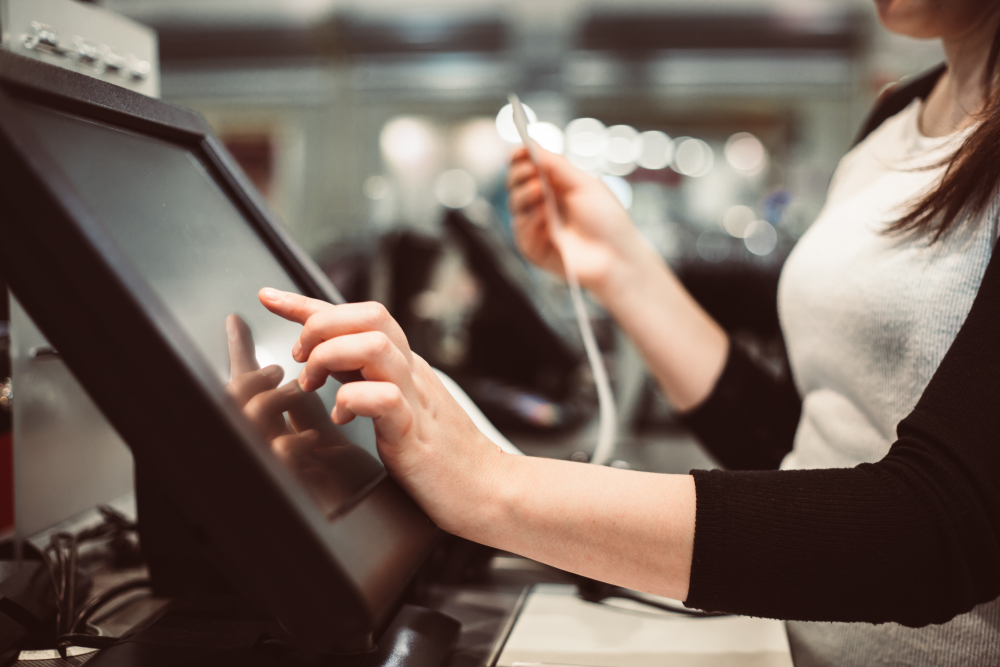 waitress chooses from list of features on restaurant POS monitor