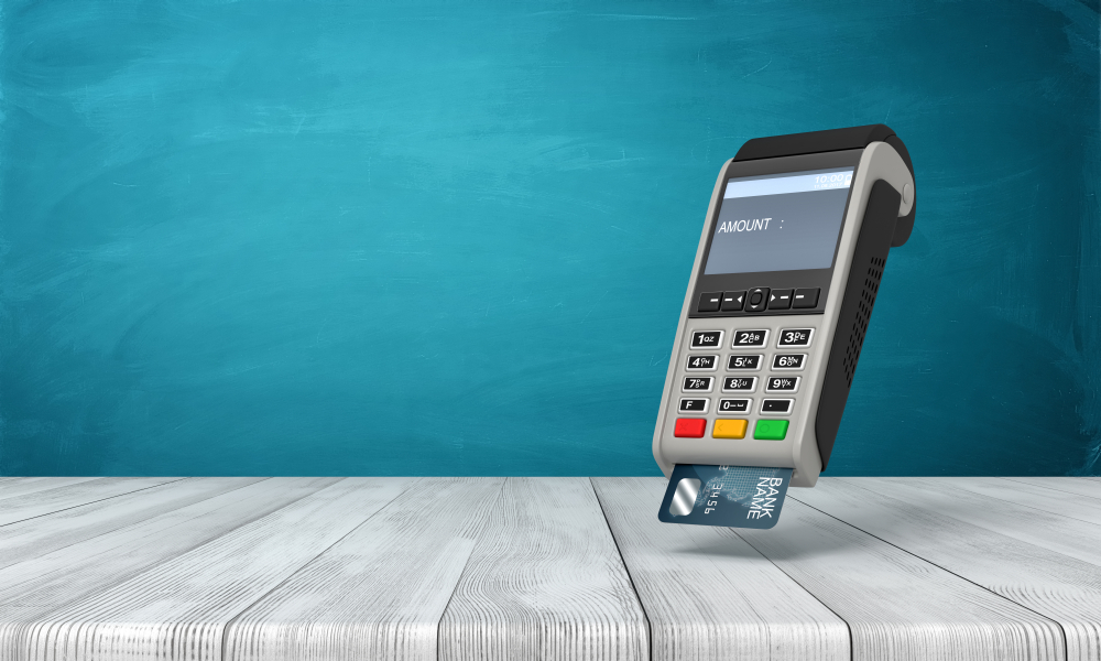 a point of sale machine reads a credit card