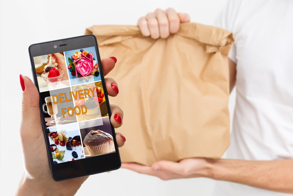 person using a delivery app on phone to order takeout