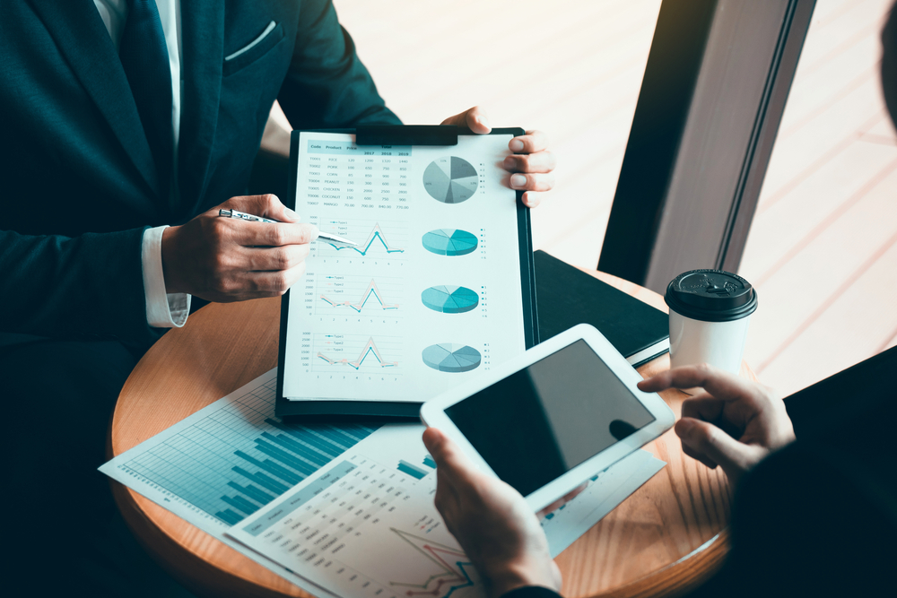 Business owners examine data on tablets