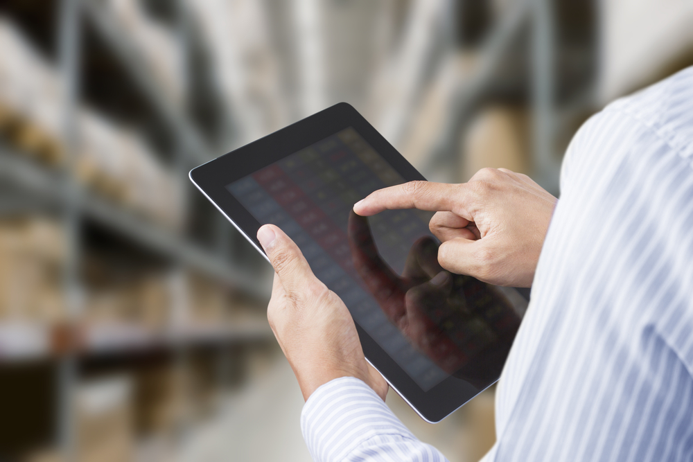 person using point of sale software on tablet for inventory control