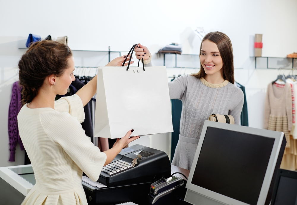 woman makes purchase in retail shop