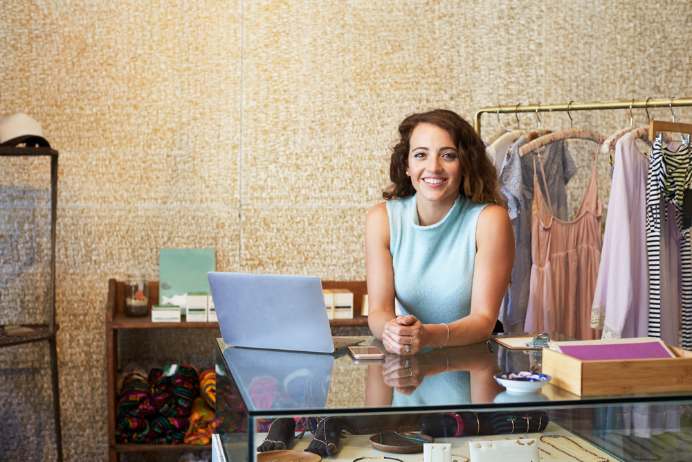 woman in retail store is pleased with her new POS system software
