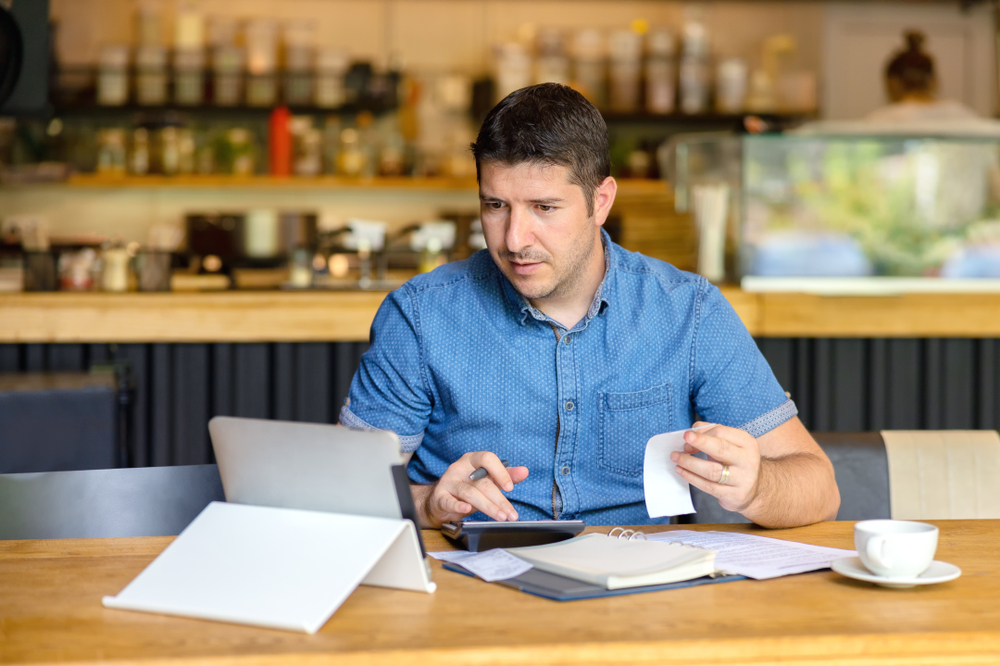 restaurant owner does accounting with POS system