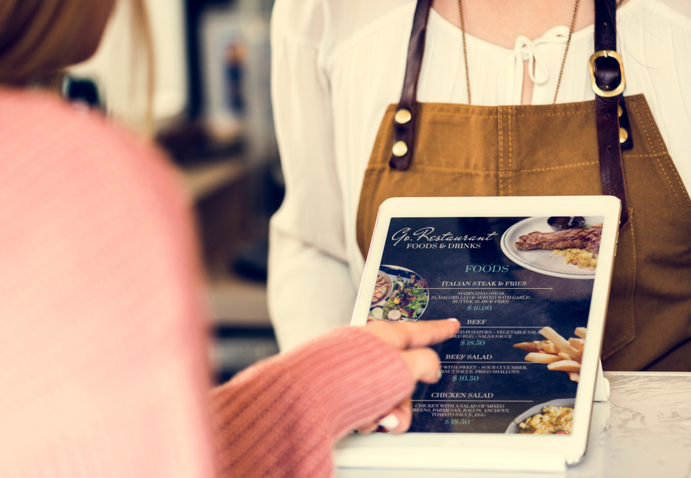 customer selects item from menu displayed on tablet