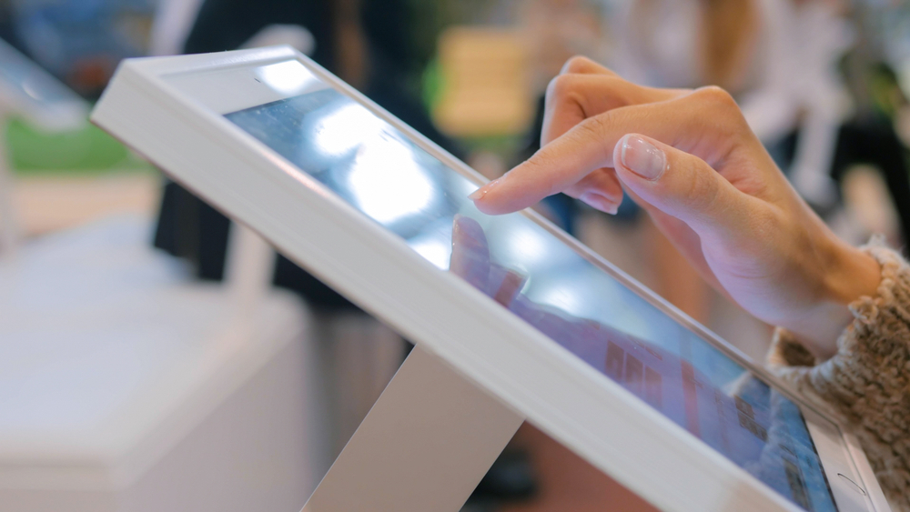 hand makes a selection on a touch screen pos register