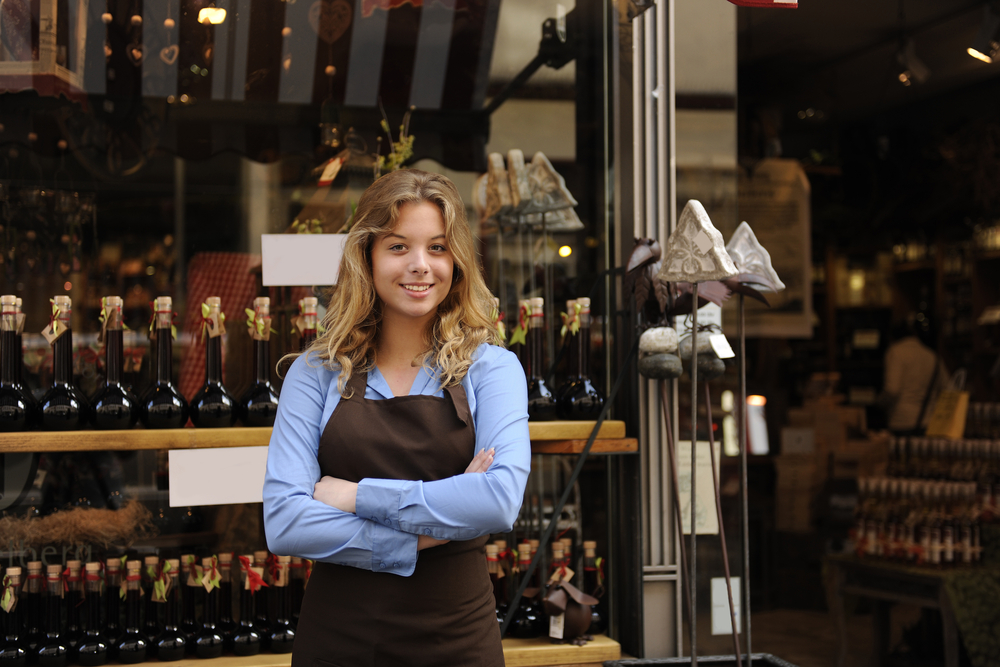 employee stands outside of wine shop