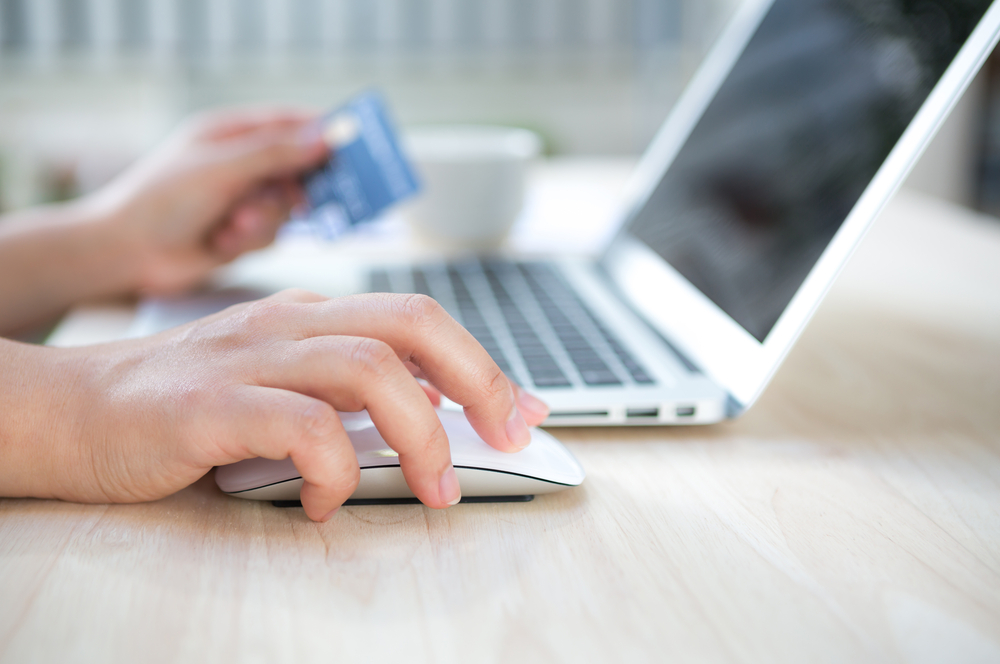A person making a purchase on their laptop
