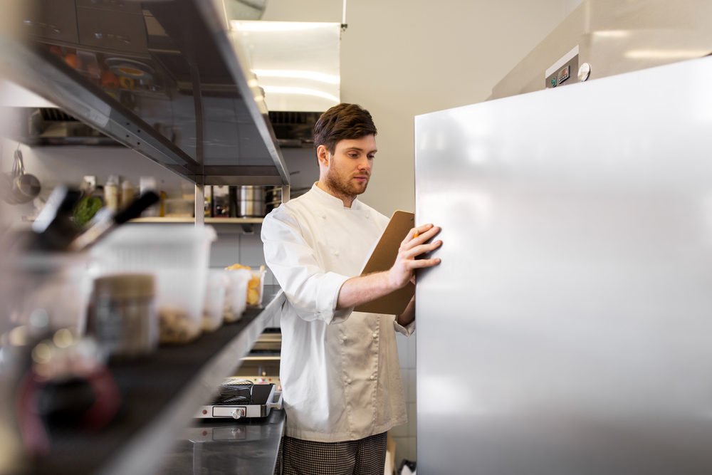 restaurant chef uses inventory management solution to assess ingredients