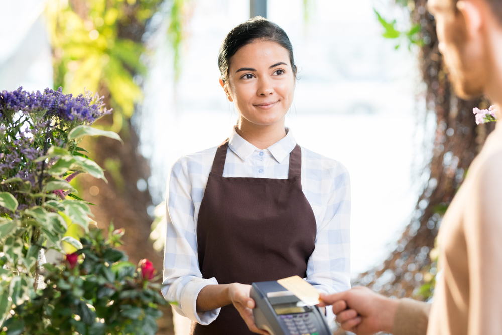 flower shop employee accepts payment on pos system