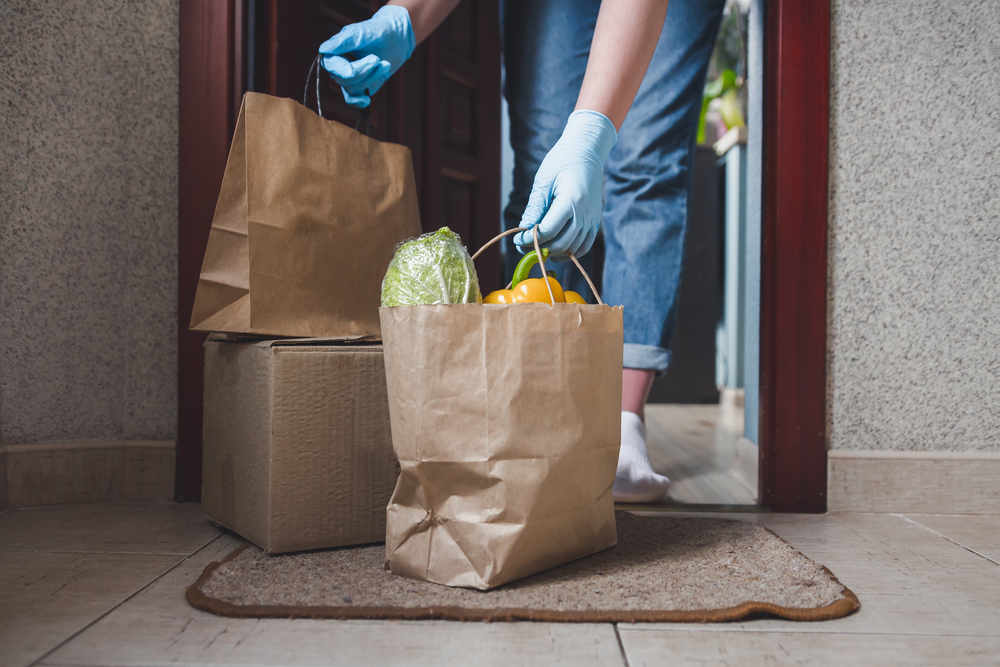 delivery person drops off food order on doorstep
