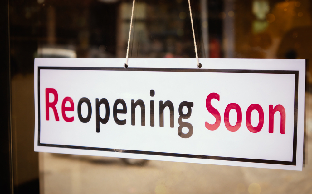 """sign on small business that reads """"reopening soon"""""""