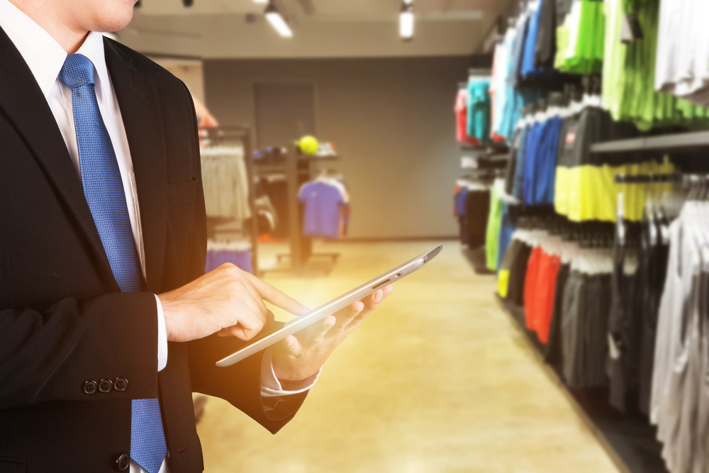 business owner tracks inventory on ipad pos
