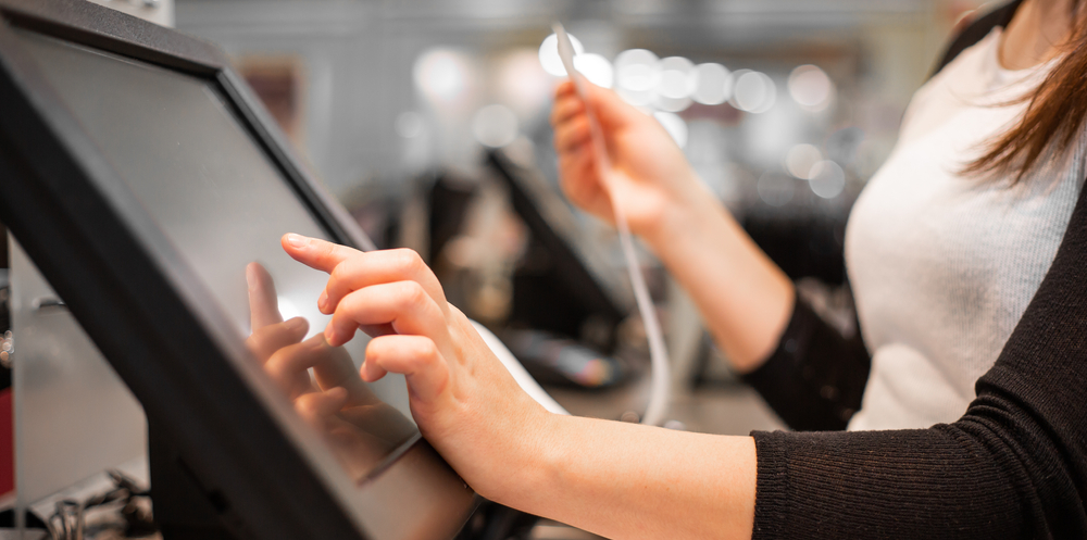 employee tracks payments on point of sale terminal