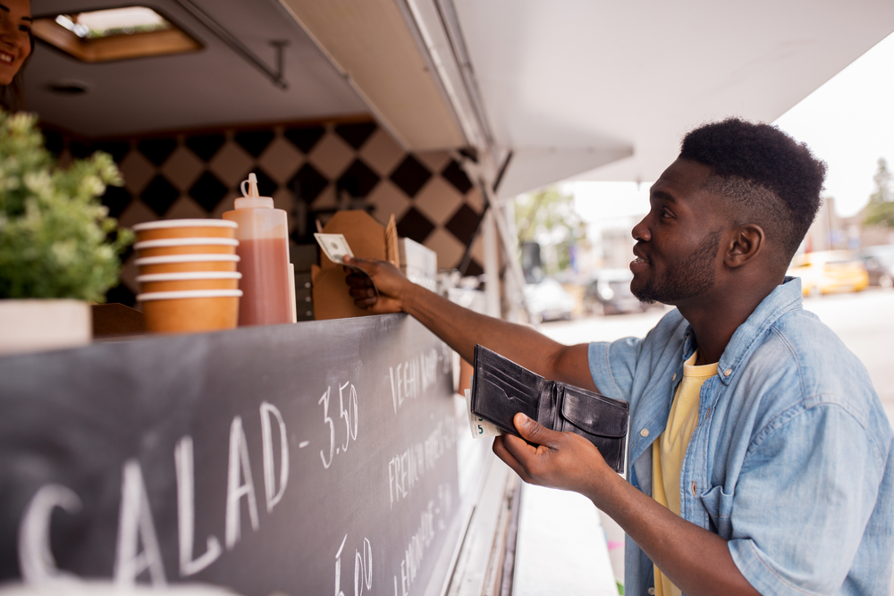 food truck customer makes purchase using mPOS