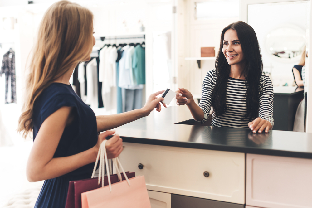 customer uses cashless payment technology at a retail shop