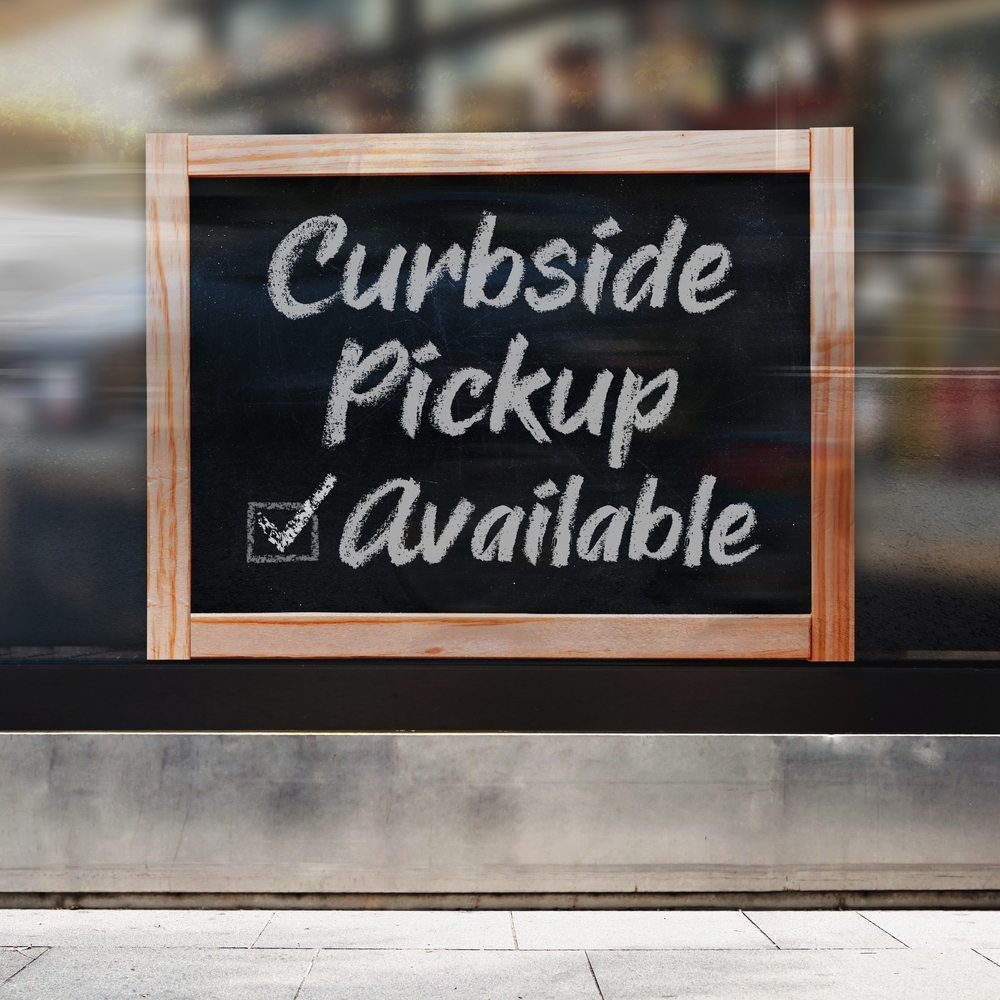 """sign reading """"curbside pickup available"""""""