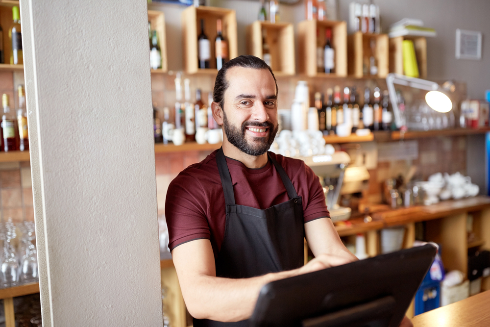 bartender uses pos to take payment