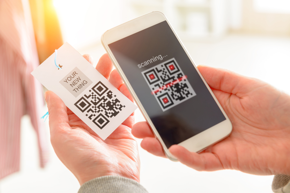 customer scans a QR code with phone