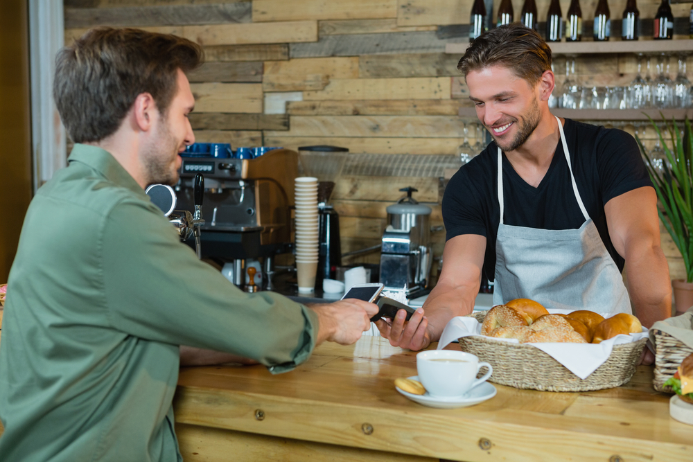 Customer makes ePOS payment at cafe