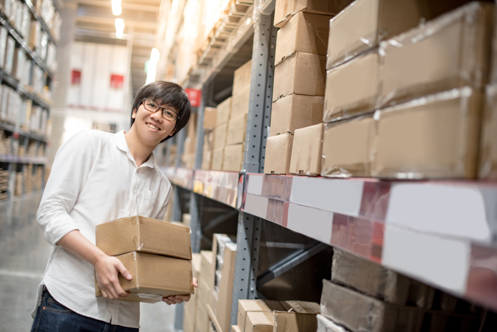 employee tracks inventory in warehouse