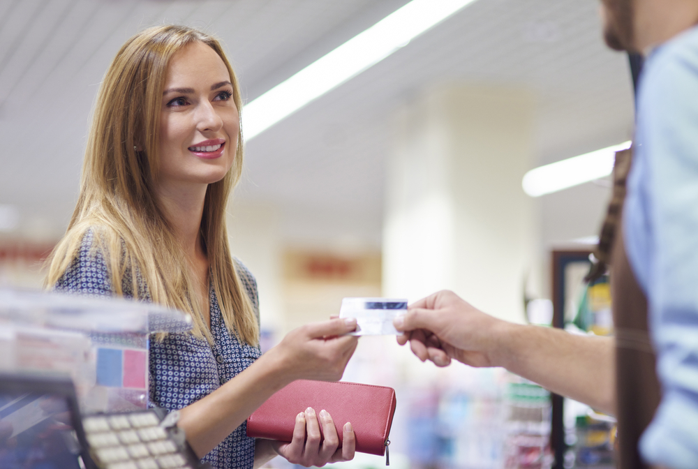 woman makes purchase with credit card at POS