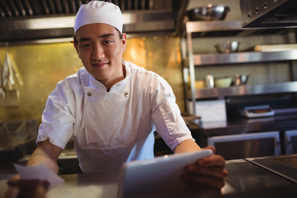 restaurant chef consults an online ordering system