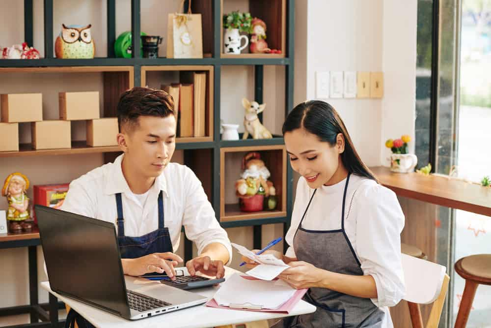Small business owner reviews invoices