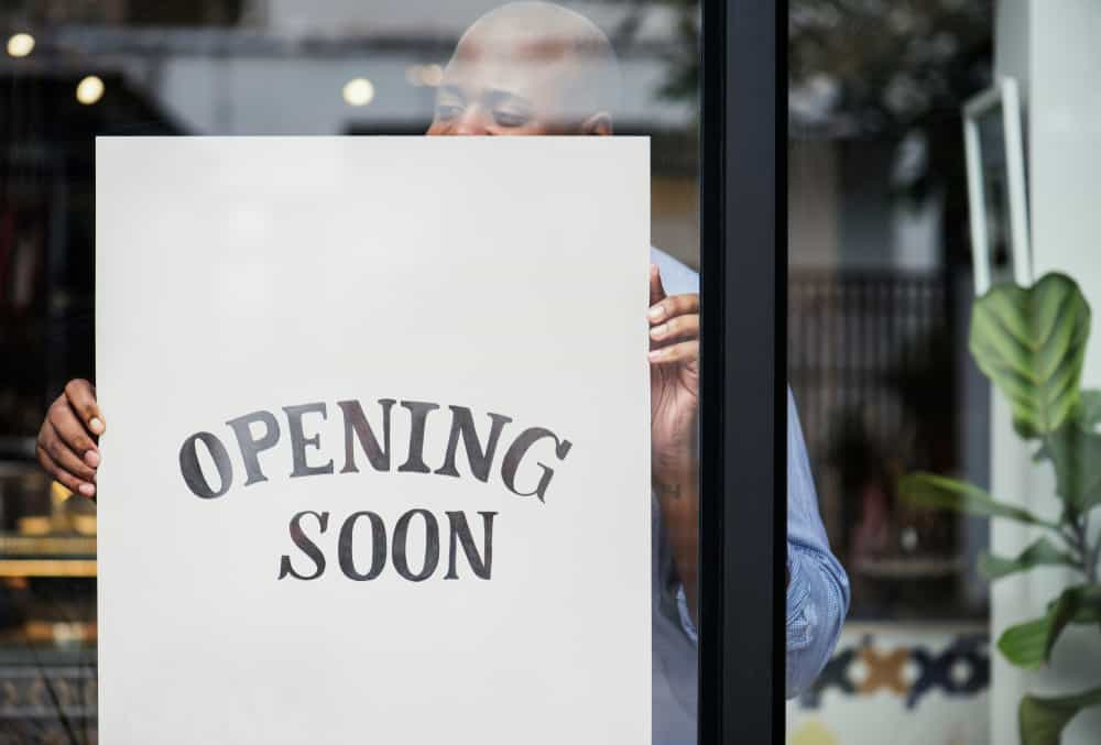 An opening soon sign; a restaurant startup costs breakdown is helpful when opening a restaurant.