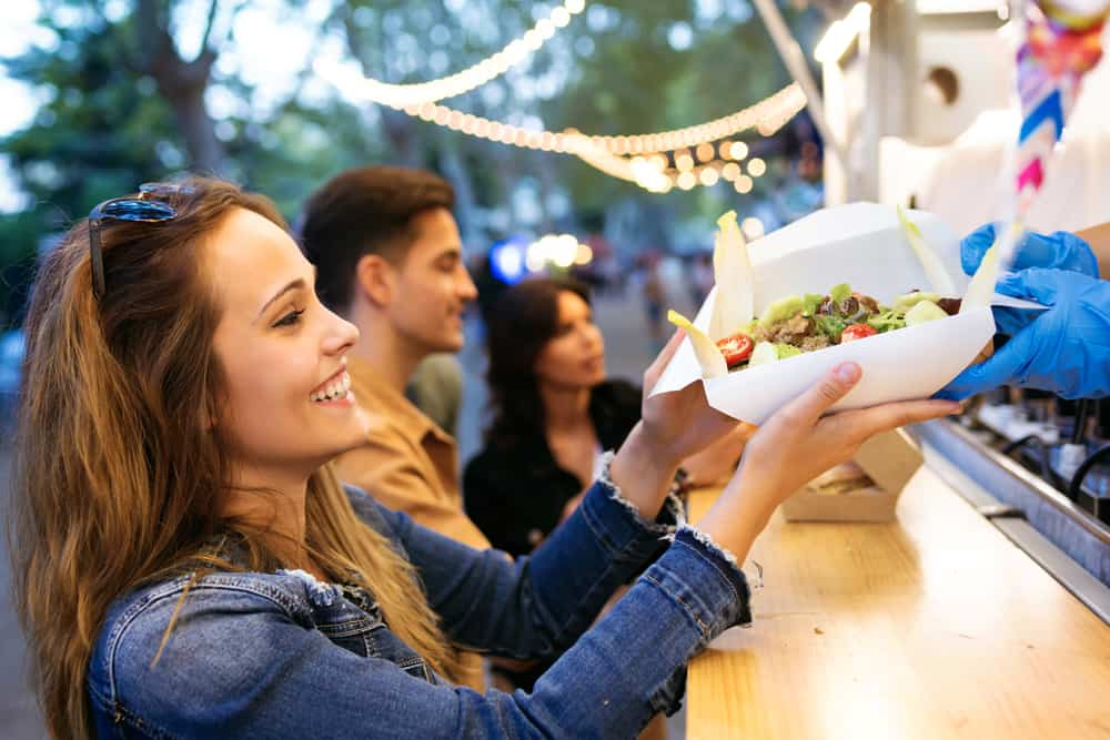 Customers of a mobile food truck at an outdoor event can still pay with their preferred digital service thanks to mobile point of sales software.
