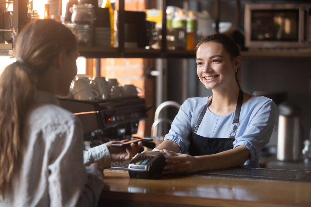 retail customer pays with credit card on POS machine