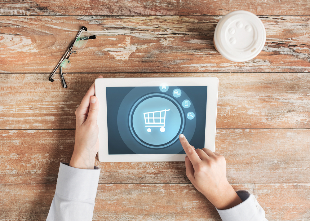 ipad user selects shopping cart icon