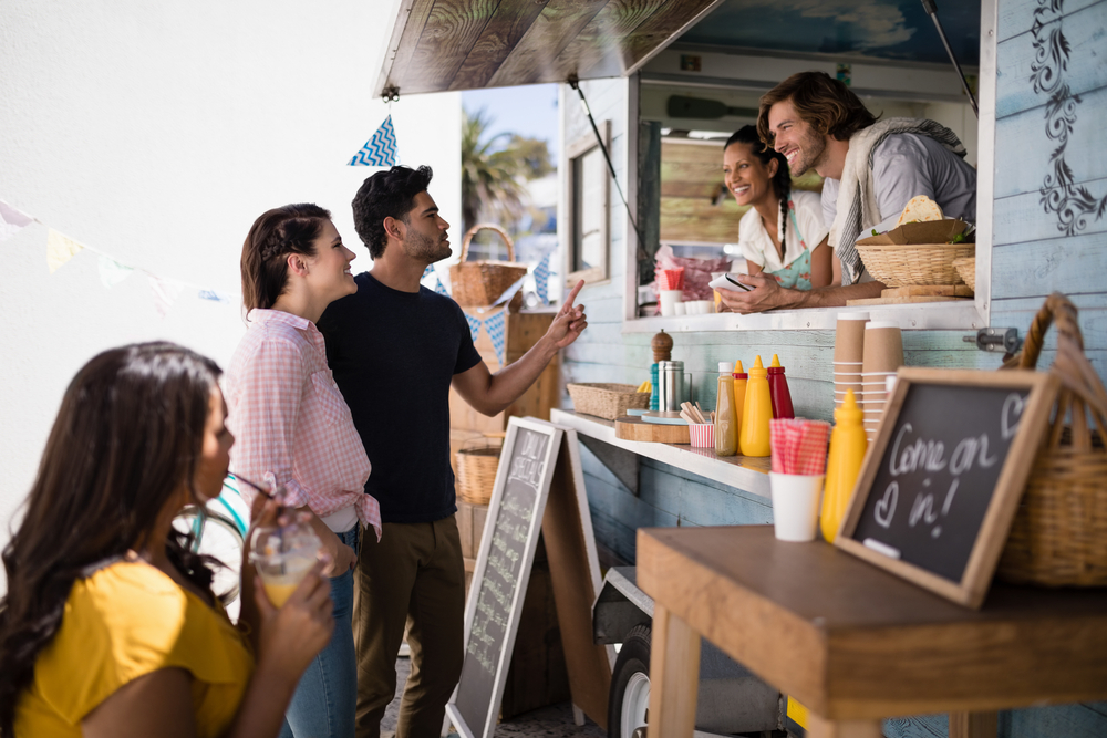 customers place orders at food truck