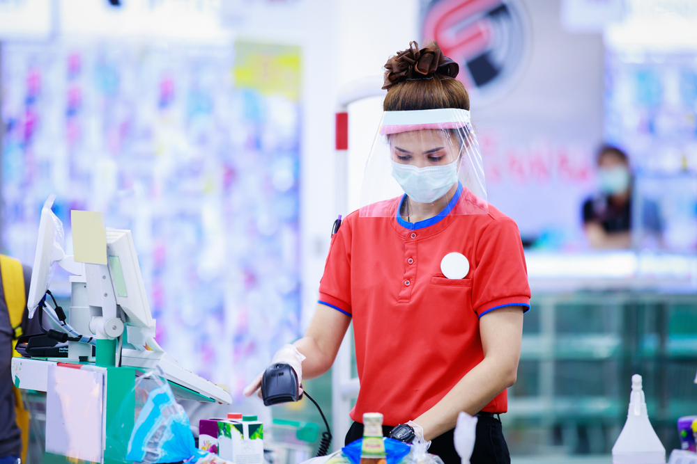 retail worker wearing PPE