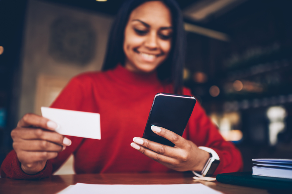 woman places online order using mobile point of sale for smartphone